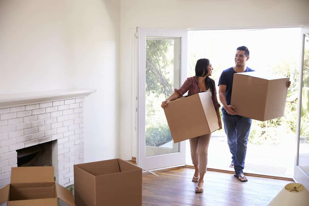 Happy Couple Moving Into Newly Purchased Home